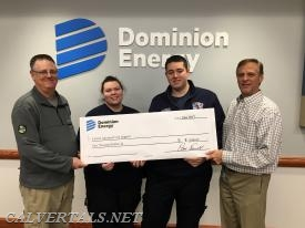 Captain Hiepler and Lt Madariaga receive a generous donation to CALS from Dominion Cove Point for their efforts in saving the life of one of the Dominion employee.
