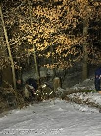 Crews down in the ravine working to package the patient.