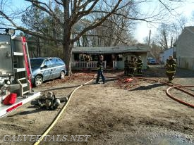Trk3 on side Alpha of the house fire.  Solomons VFD made quick work of this 1 alarm fire.