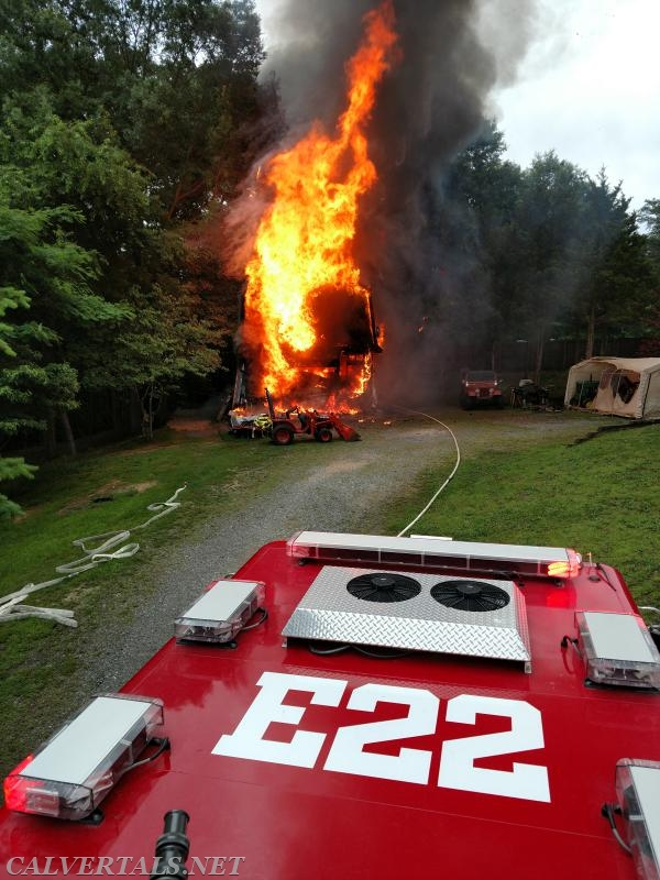 E22 and Chief 10 arrived on scene to find this 2 story shed on fire.