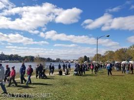 Spectators along the riverbank awaiting the race