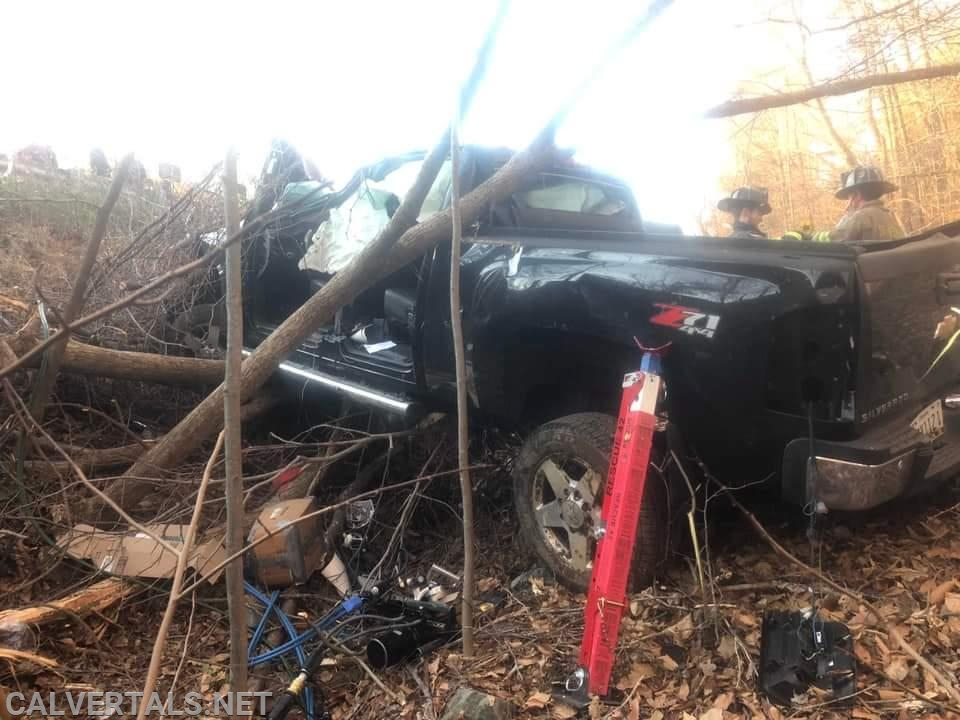 Vehicle in the woods after the crash.
