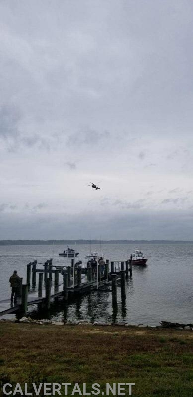 """Solomons Boat 3, NRP Rescue Boat, and """"Watchdog"""" overhead orbiting the search area."""