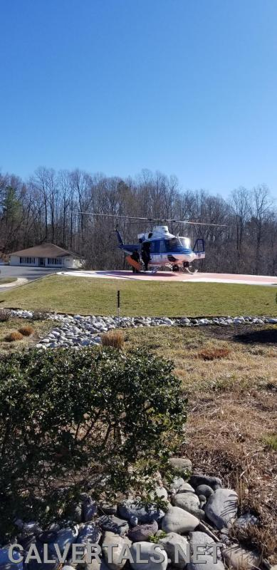 United States Park Police Eagle dropping CALS provider off at The CMH Helipad after the MVC.