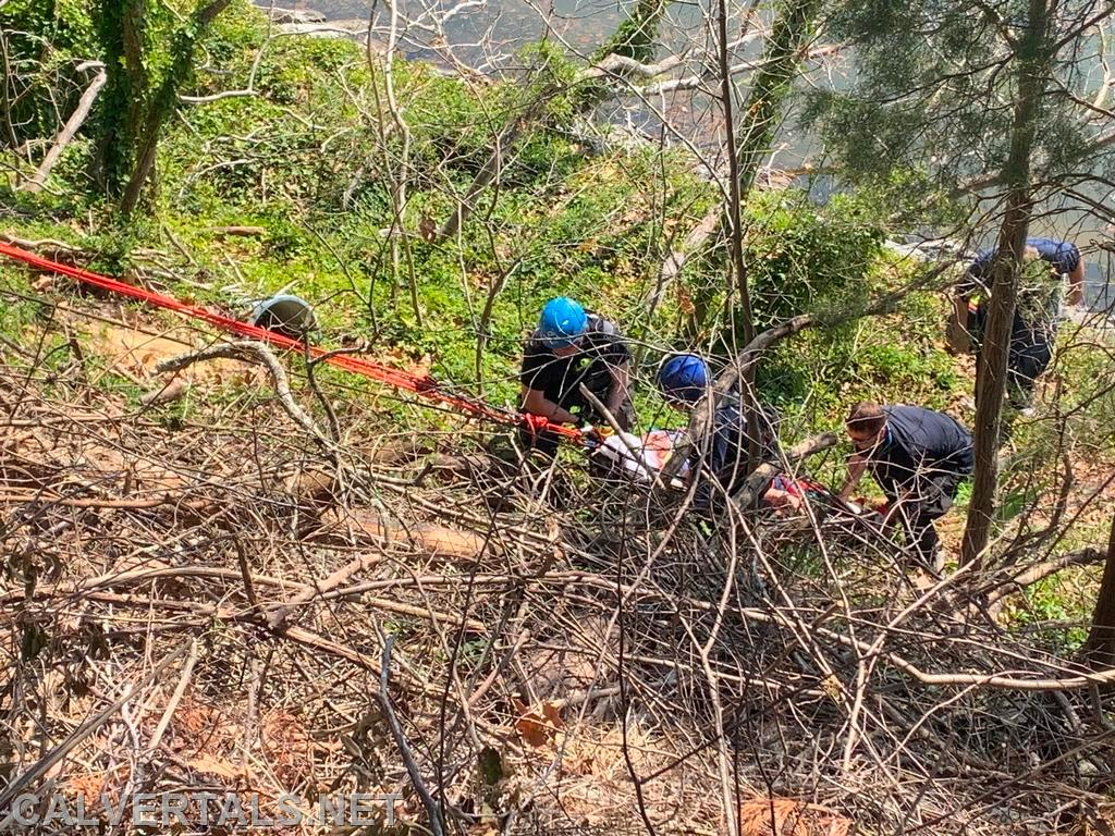 Members of the Calvert Co volunteer Technical Rescue Team removing the victim back up the cliff face.