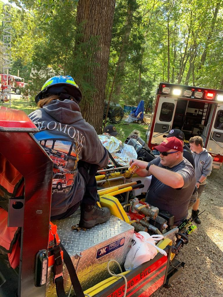 Patient being transfered from Gator3 to PA237 after being removed from the woods.